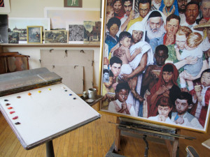 A portion of Rockwell's studio. On the easel is...Do unto others as you would have them do unto you  - 1961.
