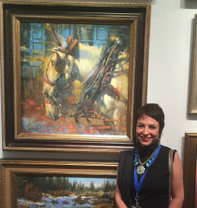 Elizabeth Pollie  with her winning painting.