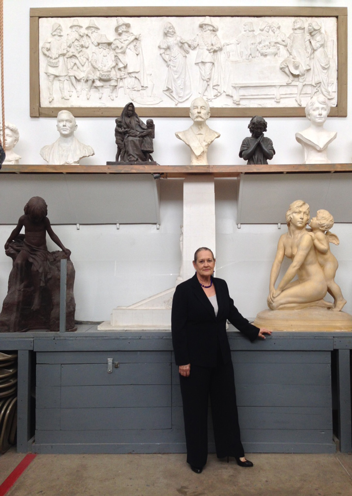 Current President, Janice Yow Hindes, with several of Coppini's works.
