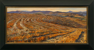 """antonio's Fields"" by Daud Akhriev, has beautiful rich colors and patterns. The painting has a wonderful flow, as seen in the patterns of the plowed fields. Hill cose a reverse scoop profile and a rich brown finish with a composition gold leaf lip. To continue the feeling of the flowing fields, on the top edge of the frame Hill carved a simple, rounded dart design on each side and bottom rail. The positioning of the carved areas was very important in keeping the viewer's eyes moving within and around the painting. A very subtle difference, but very effective."